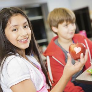 School children love fun to eat fruit