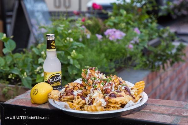 Smokehaus nachos and Mike's Hard Lemonade garnished with Fun to Eat Fruit lemons