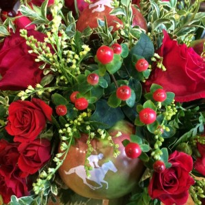 Planning a Kentucky Derby Run for the Roses party? Here's a great way to make a unique Run for the Roses centerpiece with Fun to Eat Fruit branded apples, loved by guests and equines, too!