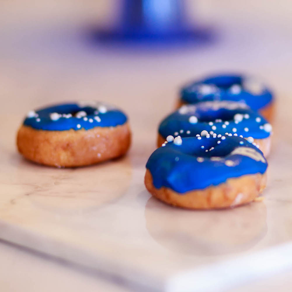 Blue frosted donuts. Scandi-inspired wedding design.