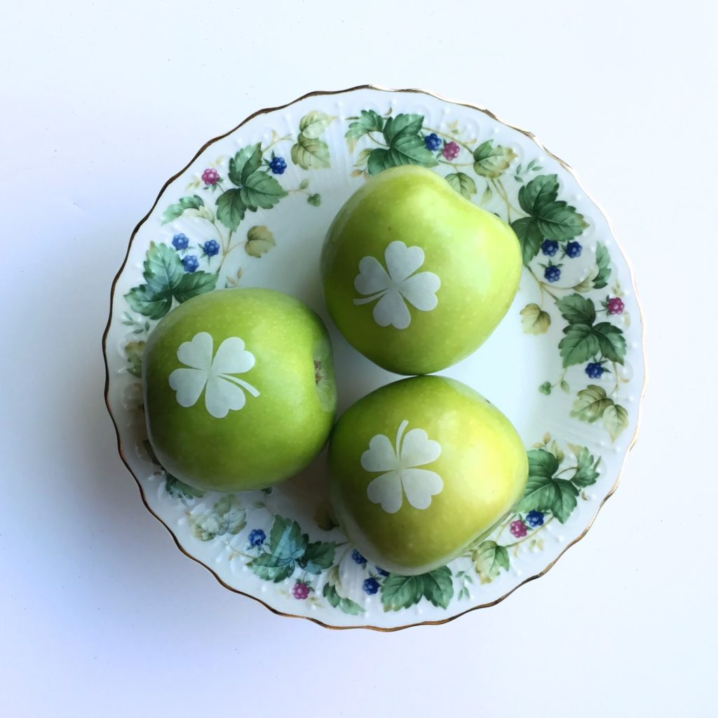 For St. Patrick's Day, how about an imprinted green apple with a white 4 leaf clover? It's all about decorating with fruit—fun non candy alternative! Click to see 9 creative, healthy, non candy treat and favor ideas. As seen on Fun to Eat Fruit www.funtoeatfruit.com #favors #favorideas #monogrammed #businessfavor #specialevents #noncandy #stpatricksday #stpattysday #ediblefavors