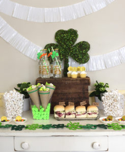 Saint Patricks Day Snack Table Setup with Green Popcorn and Shamrocks