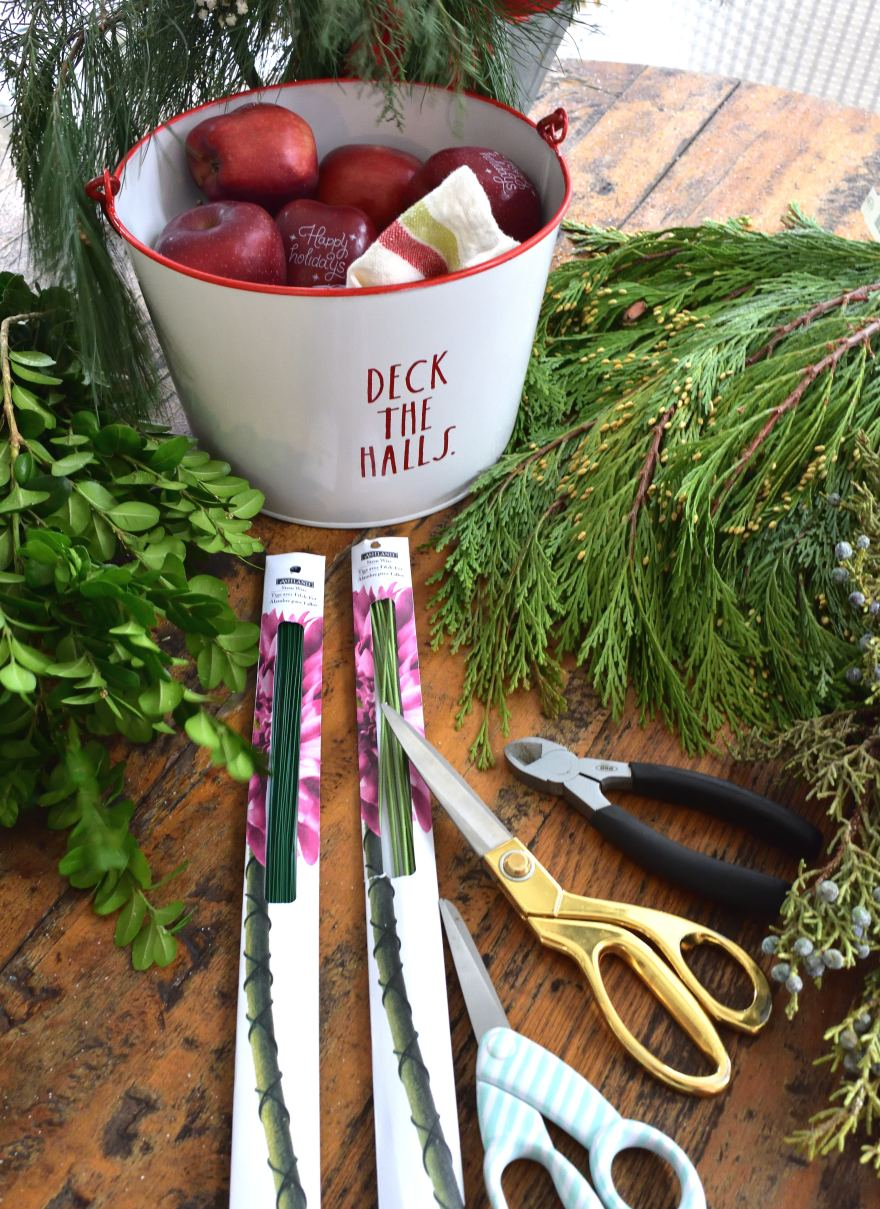 DIY a holiday wreath for Christmas! Add some Fun to Eat Fruit personalized apples for the wow factor! Check out our blog on FuntoEatFruit.com for info! #wreath #Christmas #brandedfruit #holidaydecor #diy