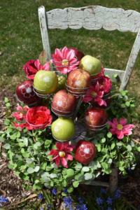 Personalized Fun to Eat Fruit apples imprinted with edible flowers are the perfect favors, decor, or snacks for your garden party! Click for more creative garden party ideas from stylist GiggleLiving.com. www.funtoeatfruit.com #garden #partyideas #spring #summer #gardenparty #ediblefavors #ediblepartyfavors