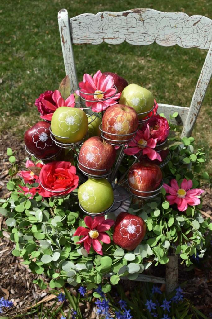 Personalized Fun to Eat Fruit apples imprinted with edible flowers are the perfect favors, decor, or snacks for your garden party! Click for more creative garden party ideas on our blog from stylist GiggleLiving.com. www.funtoeatfruit.com #garden #partyideas #spring #summer #gardenparty #ediblefavors #ediblepartyfavors